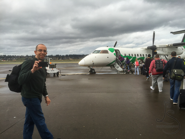 Aaron filming his way onto our little puddle-hopper from Portland to Vancouver, B.C. | BIG tiny World Travel