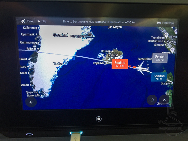 The GPS image of our airplane on the back of a seat as it crosses Iceland on its way back to America | BIG tiny World Travel