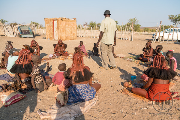 Circle of Himba selling their crafts