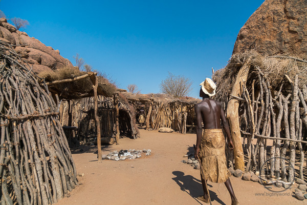 Damara tribe member walks through the village in Namibia