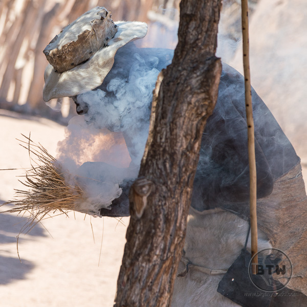 Damara man making holy fire