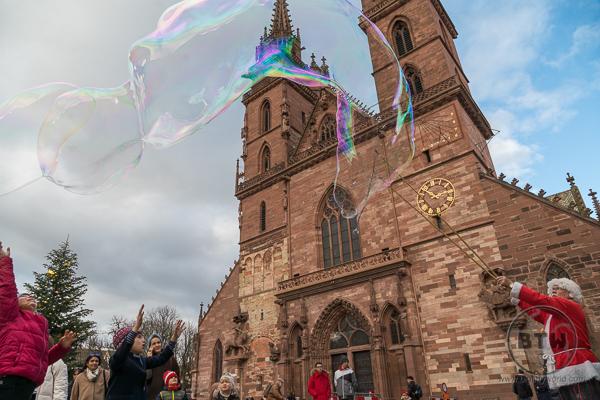 Church of Basel Switzerland with Santa making bubbles