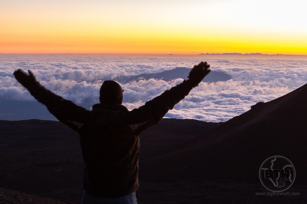 Aaron standing atop Mauna Kea at sunset