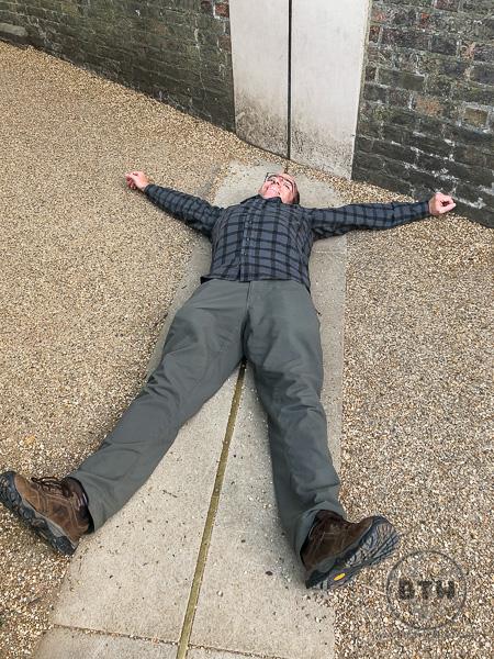 Aaron lying on the Prime Meridian Greenwich UK